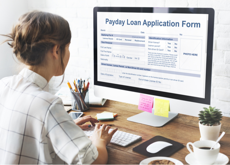 Woman filling out a payday loan application online.